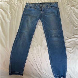 Light blue frayed bottom cut jeans